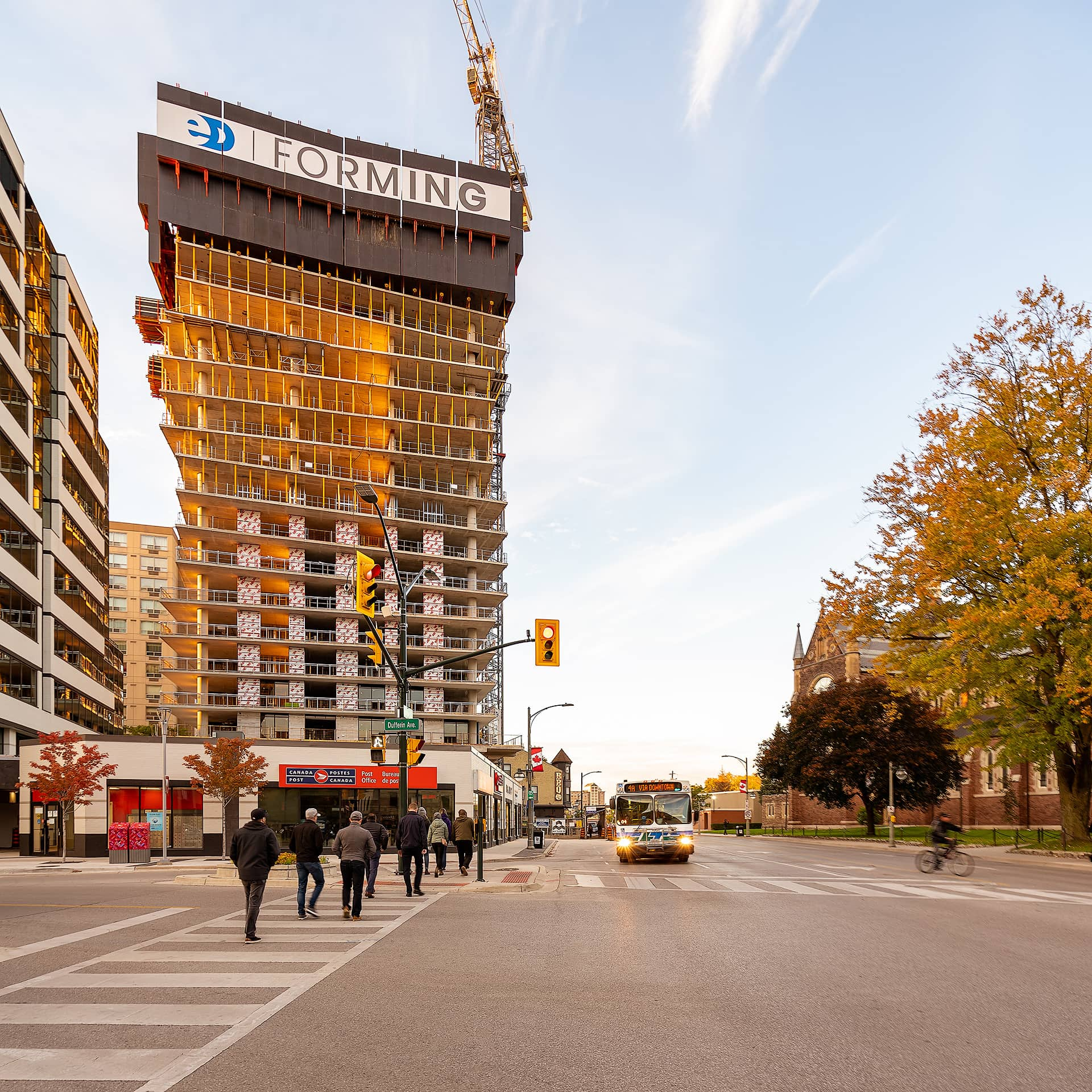 Looking towards 515 Richmond Street Building as it is under construction and there is activity on the street