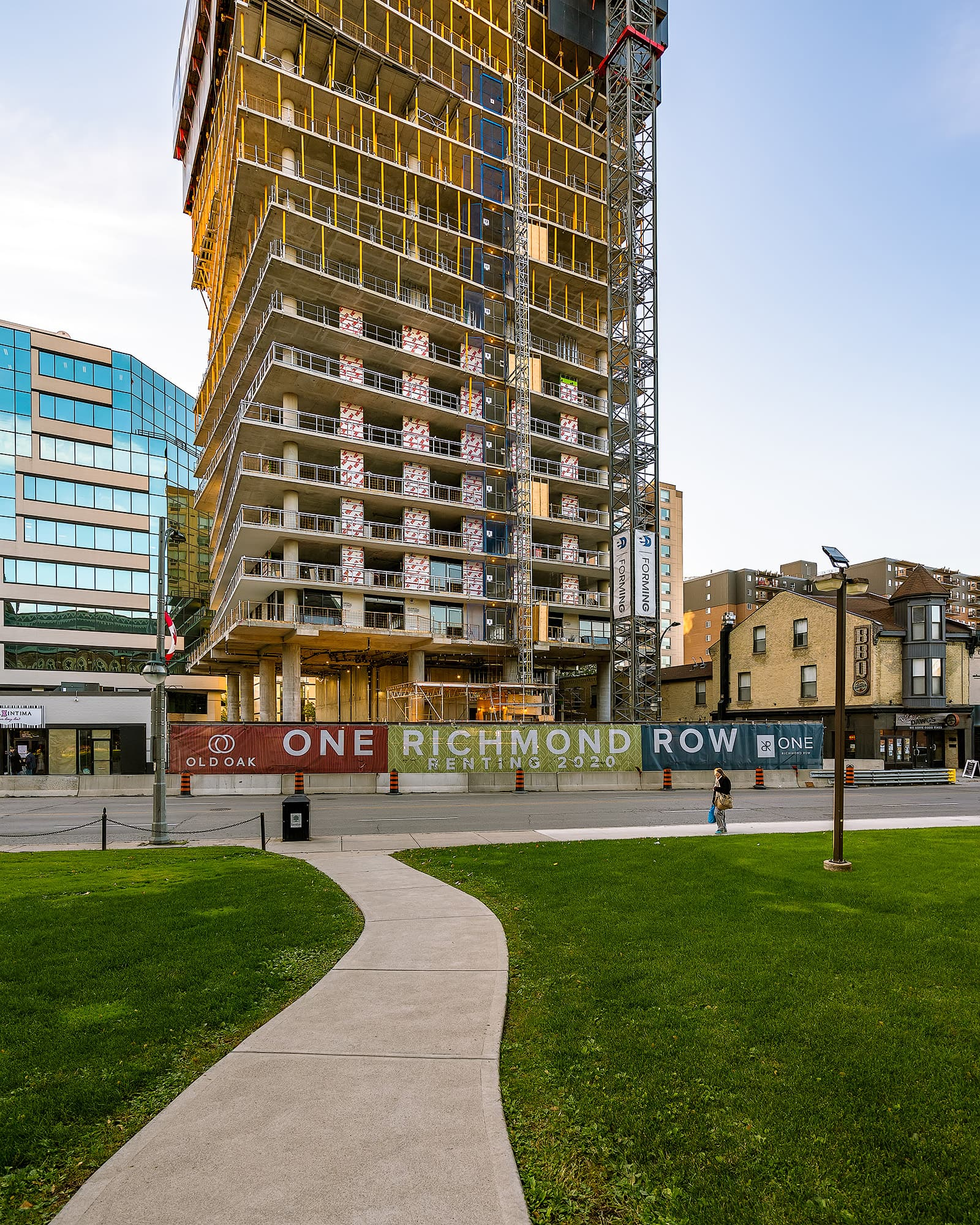 pathway leading to Twisting Highrise Building being constructed in Downtown Ldnont